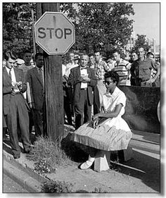 Arkansas Democrat photo by Will Counts Sept. 1957. After being heckled by protestors Elizabeth Ekford waits for bus.