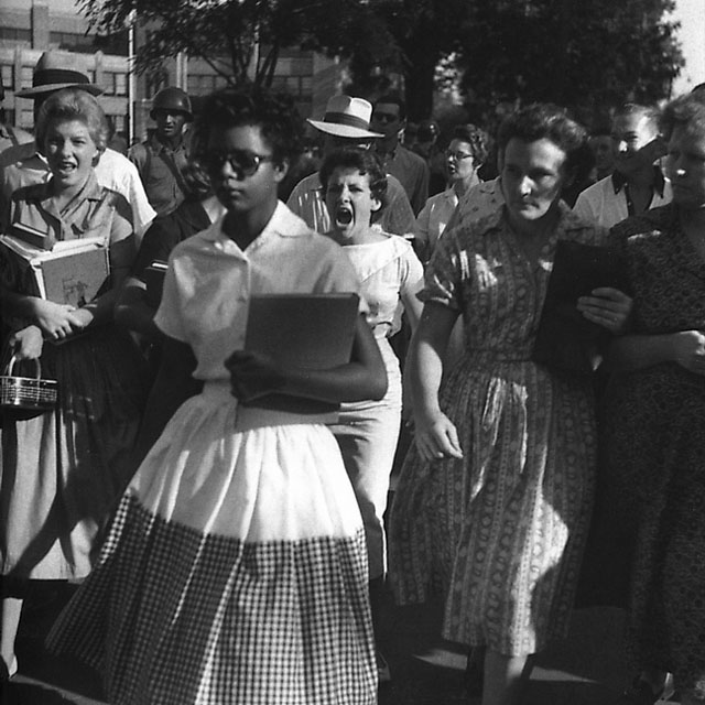 Little Rock Nine student stoically entering Central High School. Photo Credit: National Park Service