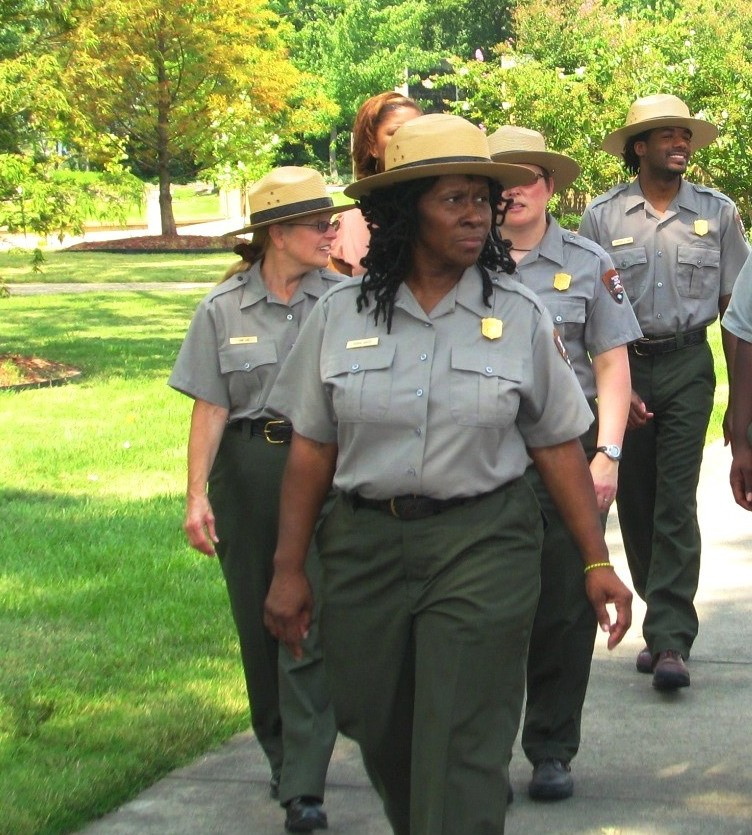 Ms. Robin White, National Park Service Superintendent with fellow NPS rangers