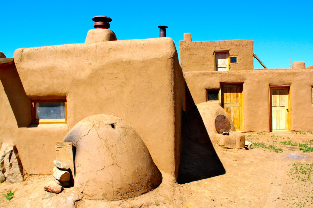 Taos Pueblo residence with orno oven in foreground