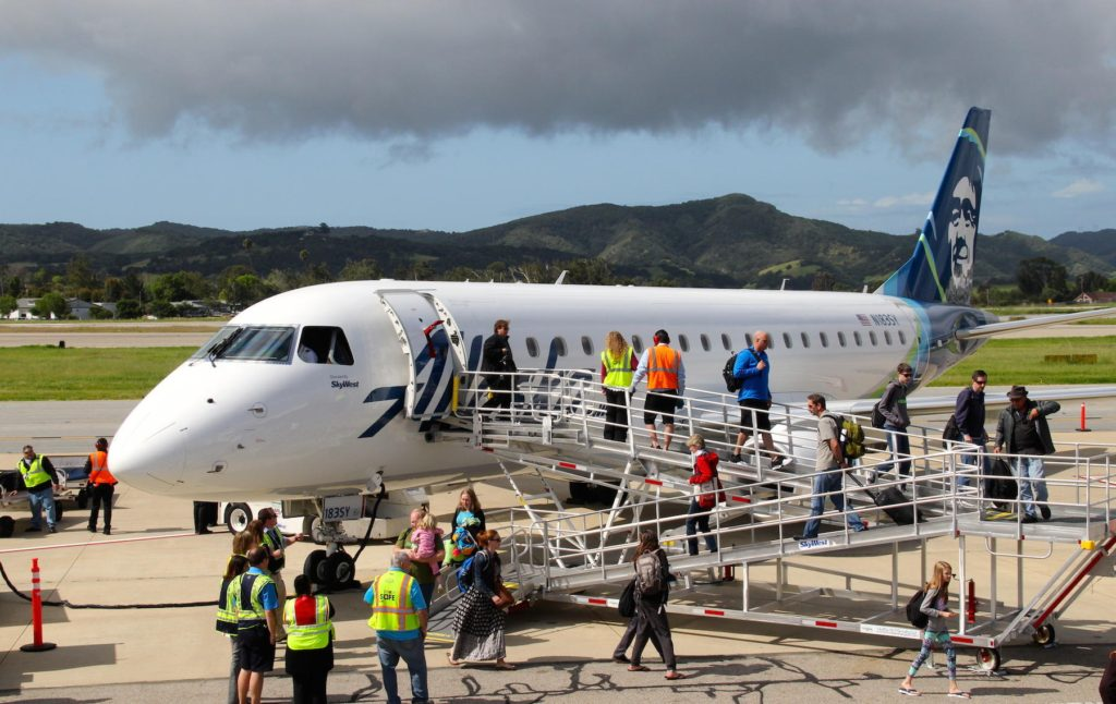 Passengers deplane in San Luis Obispo on maiden flight from Seattle. Photo Credit: Tom Wilmer