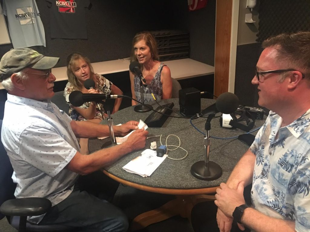 Host Tom Wilmer visits with Cal Poly Intern Randy Hair (Left) Virginia Scripps (Center) and Kain Tietzel, CEO of StartVR (Right) in the KCBX NPR affiliate studio in San Luis Obispo, California CREDIT KCBX