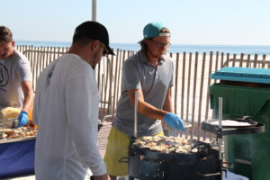 Cooking up oysters at the hangout Oyster Festival Gulf Shores, Alabama. Photo Credit: Tom WIlmer