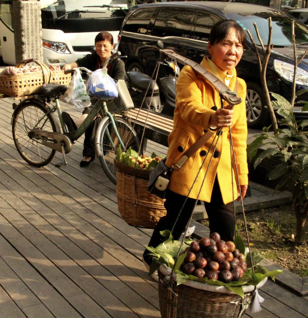 Chengdu, China street scene Photo Credit: Tom Wilmer