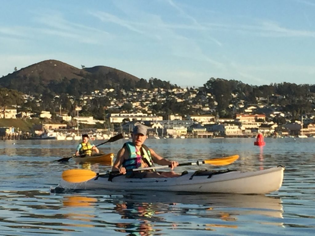 Mo Mao savoring a paddle on Morro Bay. Photo Credit: Tom Wilmer